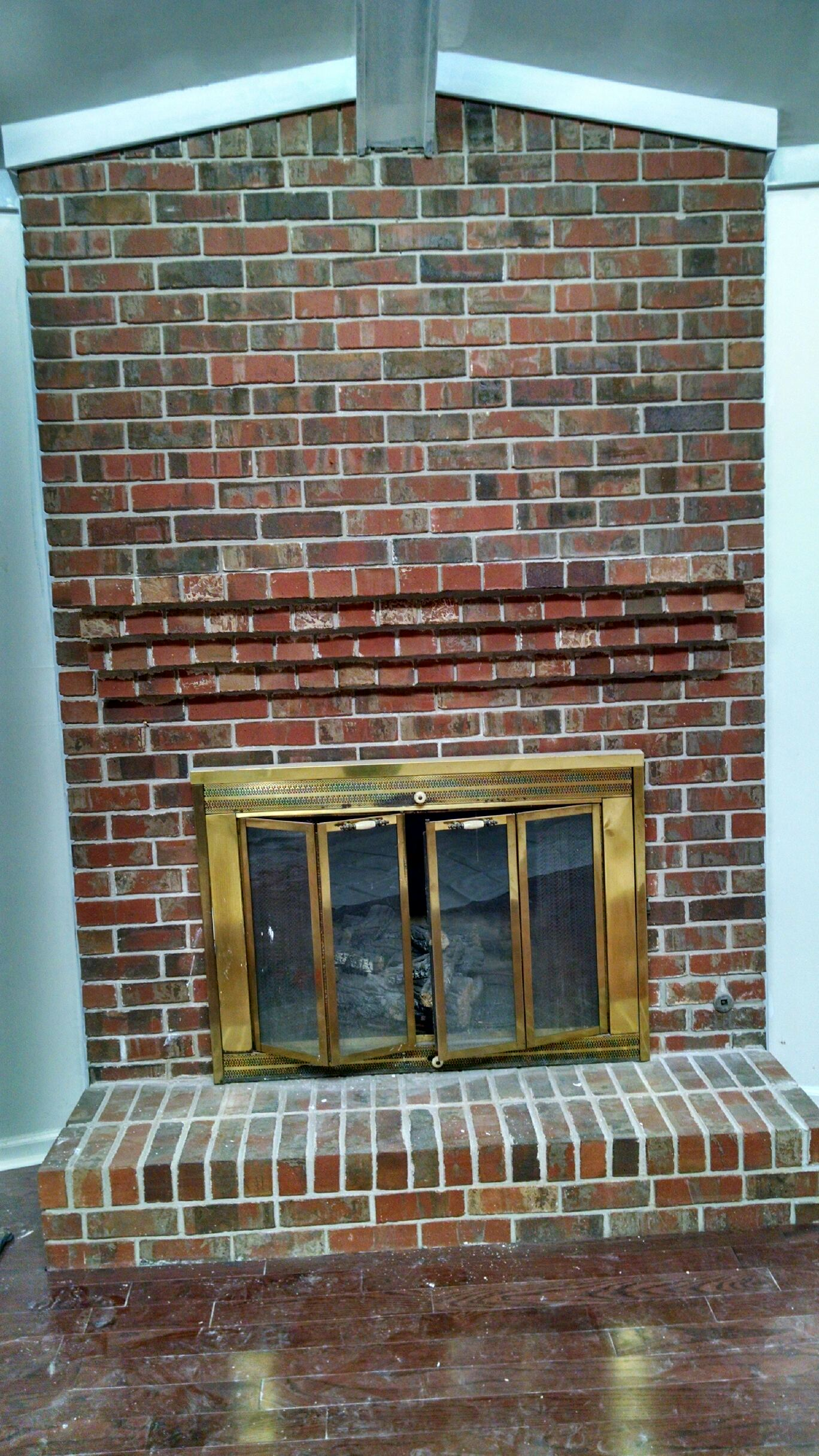 brick fireplace makeover diy - whitewashing brick