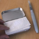 Tuck a folded up paper towel inside for later use.