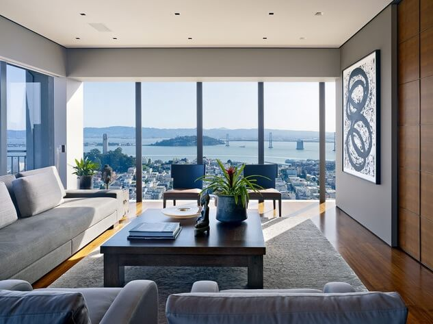 Modern-living-room-with-abstract-art-and-city-views