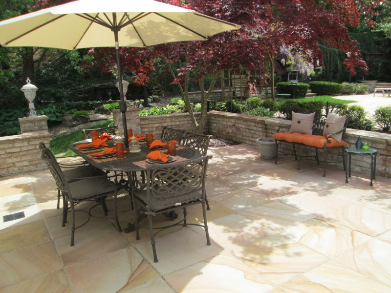 Staging Outdoor Living   Orange decor stands out against earth tones Design Remix  Inc