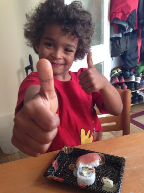 Small Sawyer eating Sushi