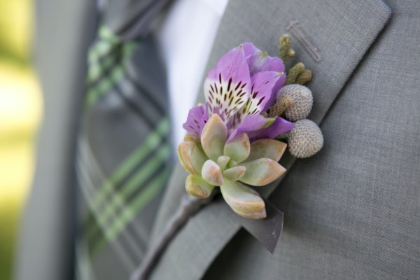 Groom's boutonniere purple and white