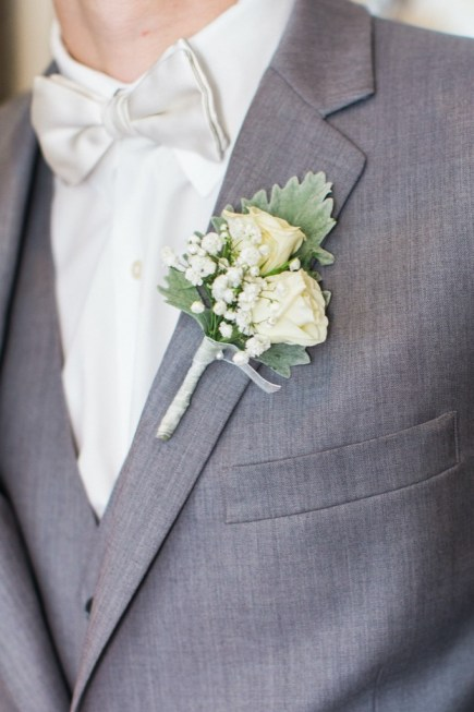 white floral groom's boutonniere