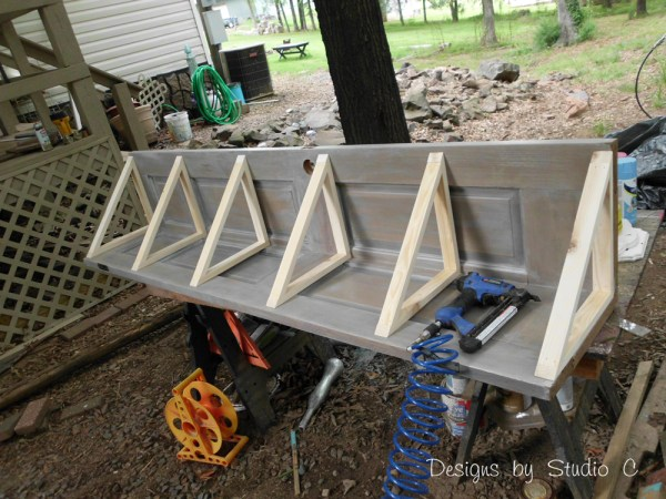 how to build a corner bookcase using an old door SANY2451