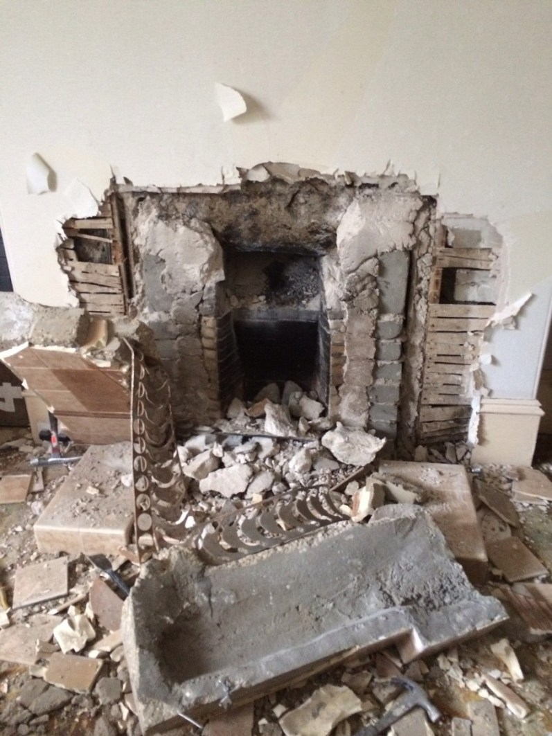 Fireplace makeover; destruction