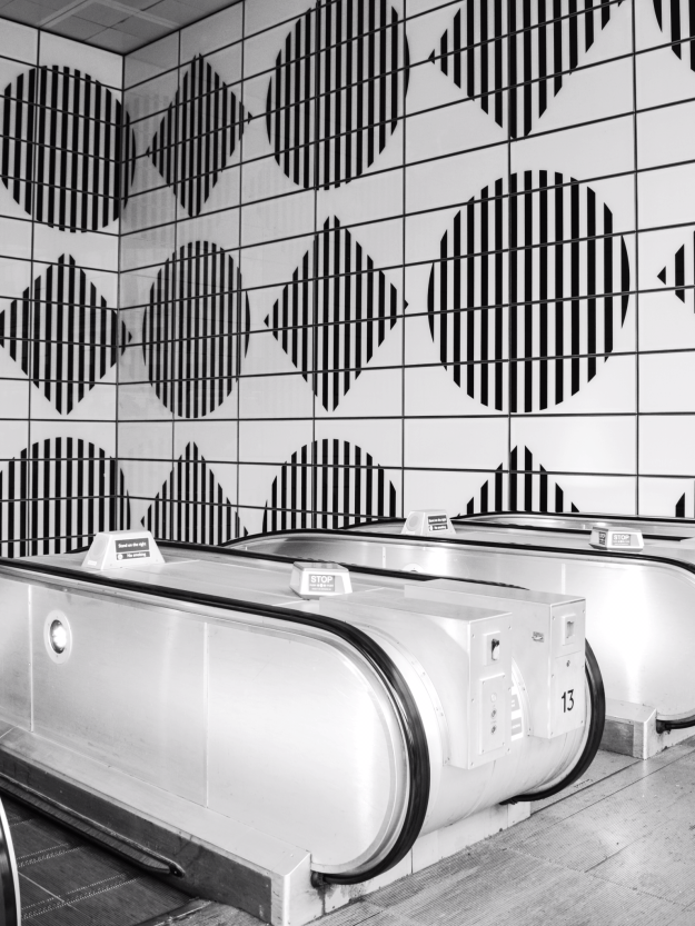 Tottenham Court Road station, geometric monochrome tiles, vintage transport