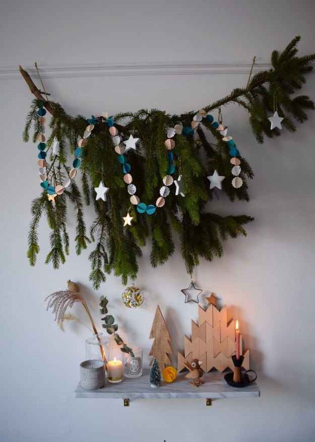 decorated pine branch instead of small chritmas tree, scandinavian styling, hay wood blocks, Rosendahl bird, pia cloud garland, white interior