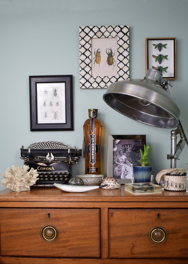 How to style a Vignette or suface, interior design stylist tips and tricks eclectic-modern-bohemian-vintage-interior-decor-farrow-ball-teresas-green-industrial-lamp-typewriter-natural-history-shells-
