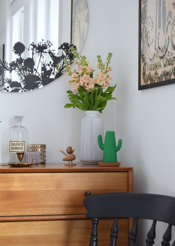 bohemian modern bedroom, summer styling, dusty pink apricot stovks, west elm chest drawers, painted black chair