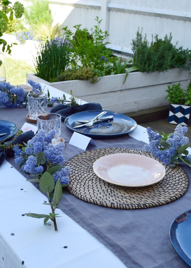 simple relaxed outdoor tablescape ideas, scandinavian linen pink and blue theme with natural accents