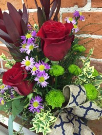 High style floral table arrangement by Designs on the Boulevard in Geneseo, IL