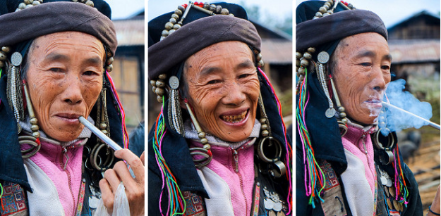 An Akha lady poses with her pipe.
