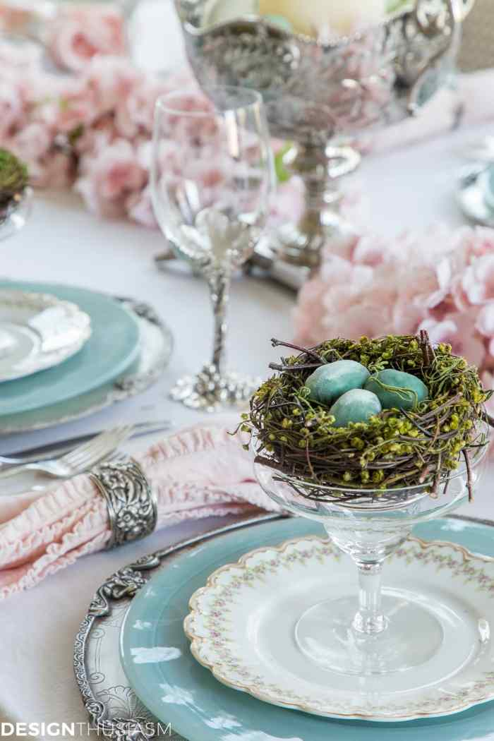 Easter table setting with nests and cherry blossom branches