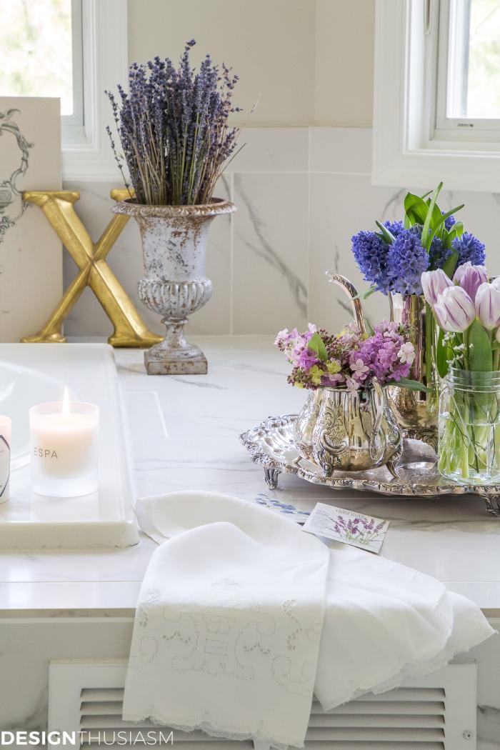 summer refresh bathroom decor with purple flowers
