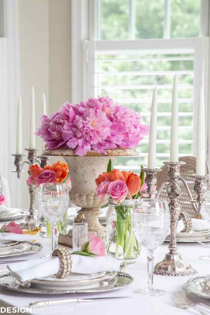 white dining table setting with summer flowers