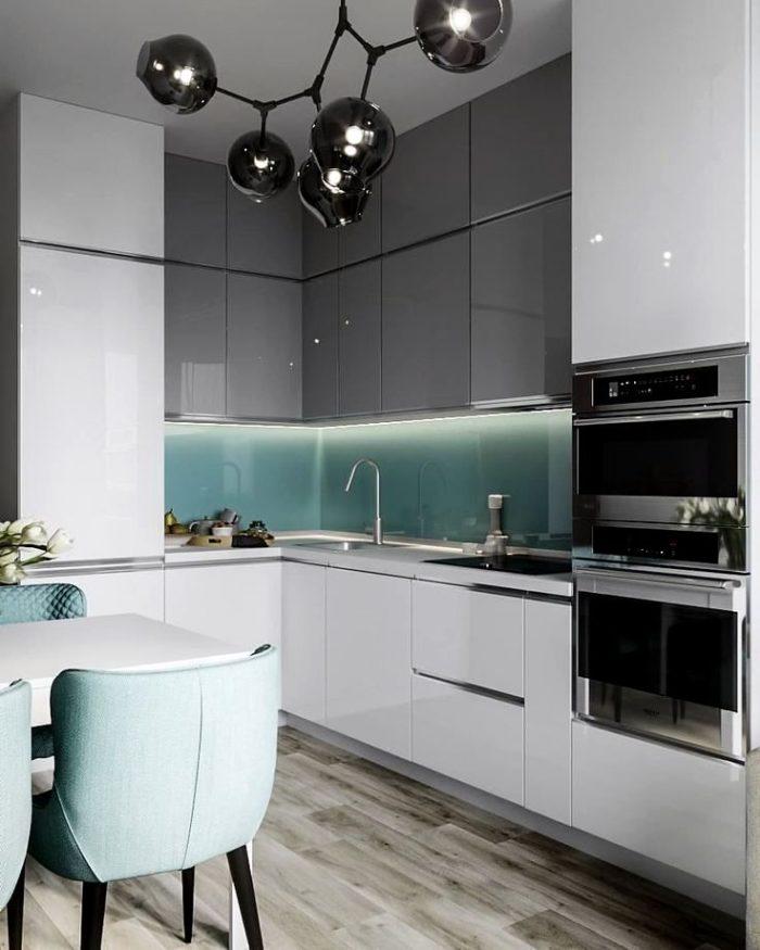 Vit kök design i minimalism stil med marmor ö