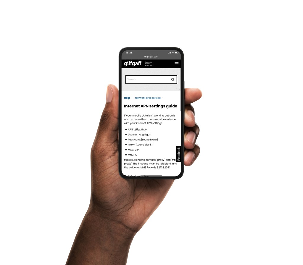 A mobile phone in a hand with the giffgaff internet APN network settings website shown on it.