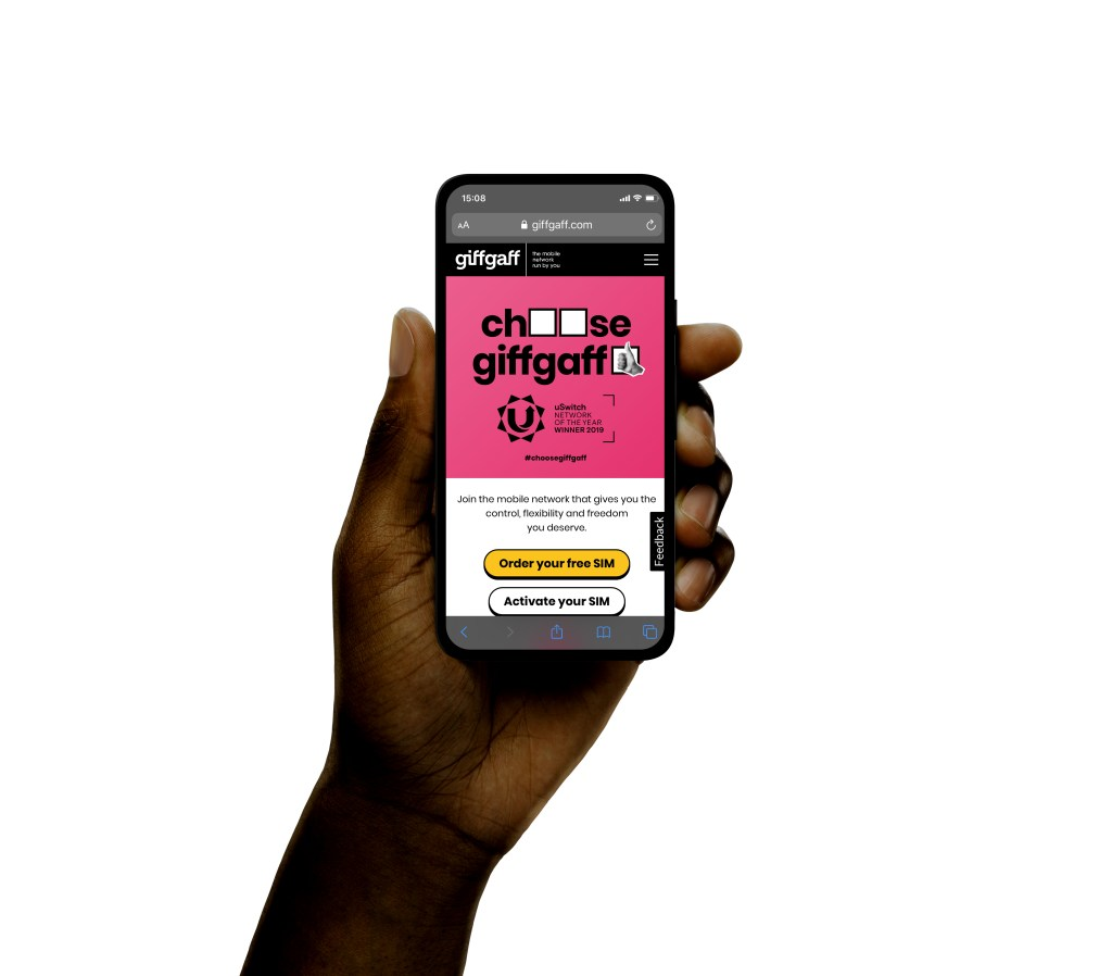 A cell phone in a hand with the giffgaff website landing page on it