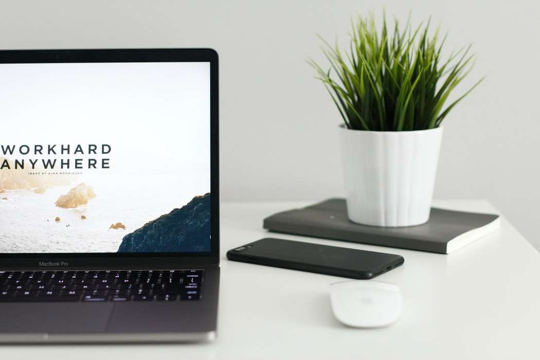 A homepage of a website open on a laptop.
