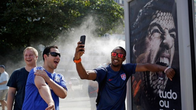 suarezbite4 650x365 World Cup Tourists Take Selfies With Toothy Suarez Ad