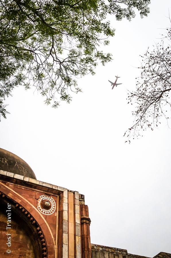 Plane flying over Mehrauli