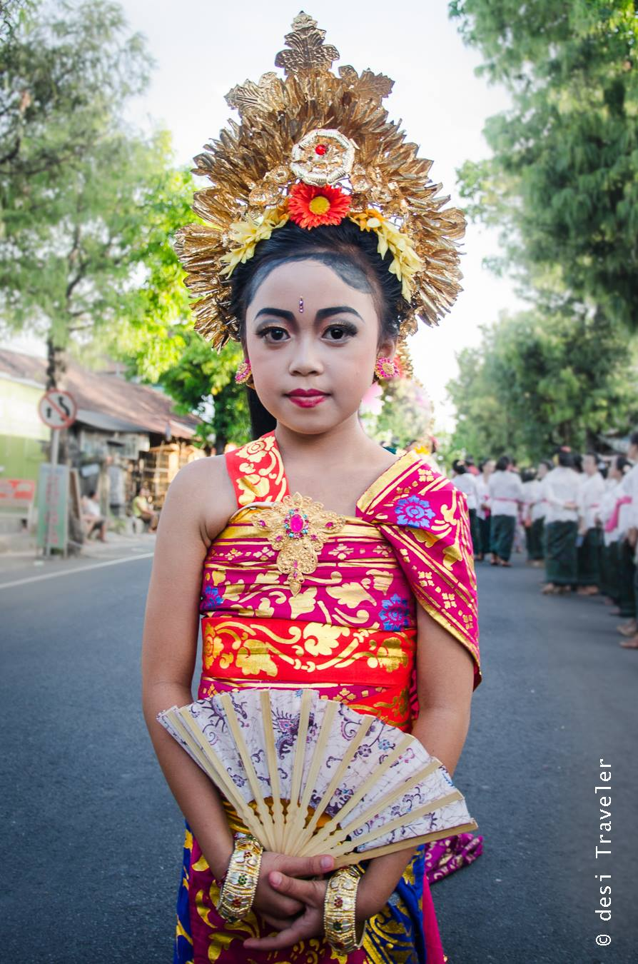 Girl with hand fan Hindu temple festival Bali