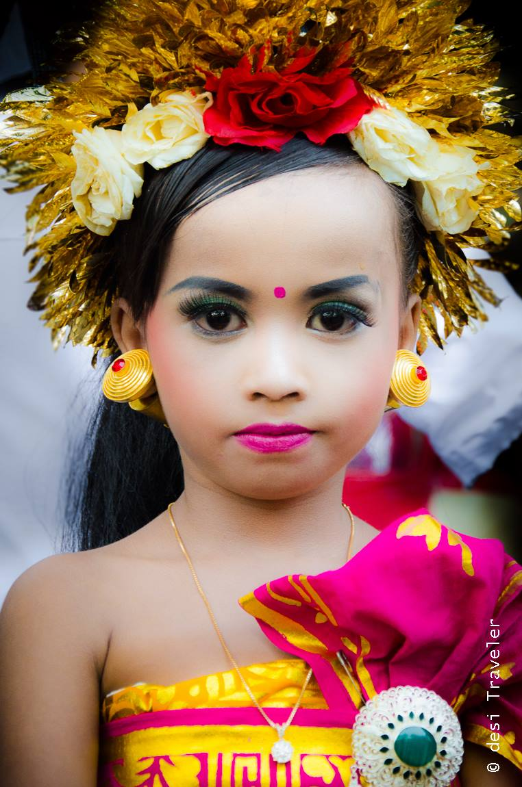 Little girl dressed as goddess in the temple ceremony in Bali Indonesia