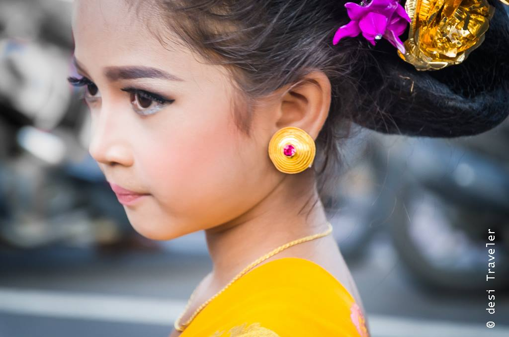 Girl dressed in traditional dress for Hindu Temple Ceremony Bali Indonesia