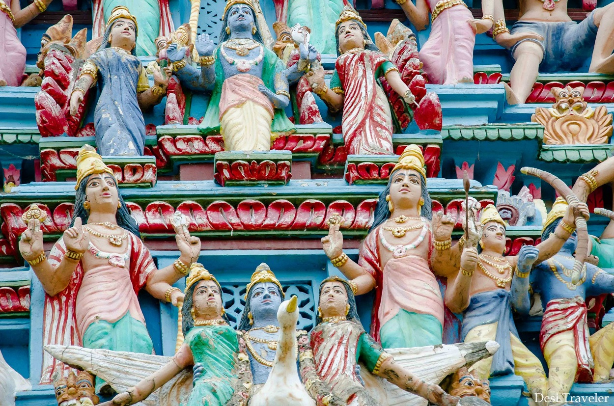 colorful idols on top of Hindu temple gopuram in South India
