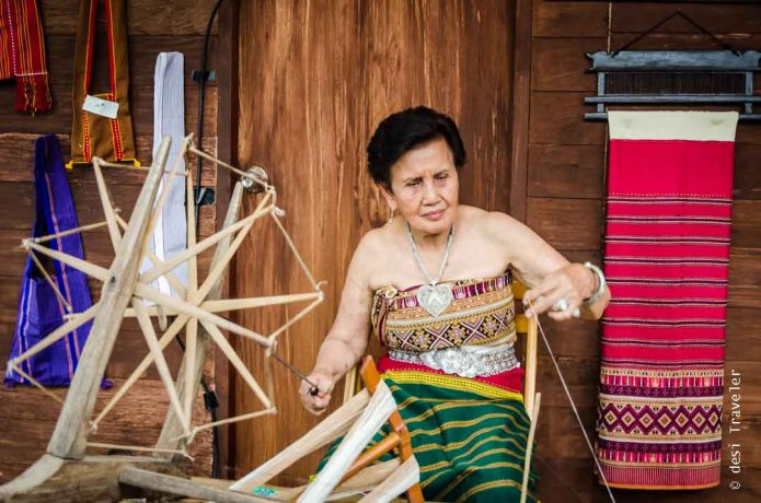 Women working on spinning wheel in Thailand