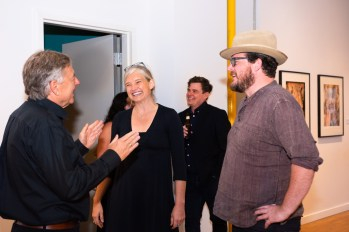 Stan, left, greets Alumni Courteney Coolidge and David Johnson at the Stan Strembicki & Alumni Art Show Opening Reception, Des Lee Gallery, St. Louis, MO