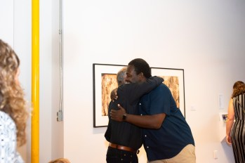 Stan greets Aumni Arthur Fields at the Stan Strembicki & Alumni Art Show Opening Reception, Des Lee Gallery, St. Louis, MO