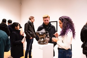 """Gallery Visitors talking about """"Dime Piece"""" by Lola Ogbara, Parabola: Assembly exhibition, Des Lee Gallery, Washington University, St. Louis, MO"""