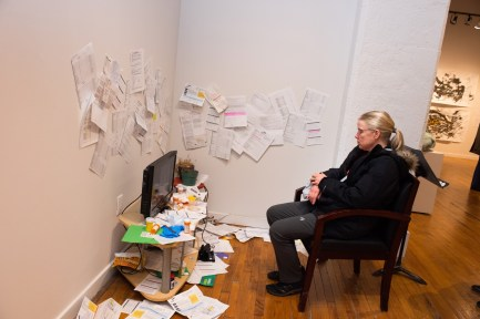 """Karla Endicott views the installation created by her daughter-in-law Lacy Murphy titled """"Living Room (Authorization for Disclosure)"""" at the Parabola: Assembly exhibition, Des Lee Gallery, Washington University, St. Louis, MO"""