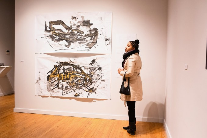 """Gallery Visitor viewing the piece """"Sam Fox Metabolic Dynamics system dynamics model"""", by Andrea Godshalk Parabola: Assembly exhibition, Des Lee Gallery, Washington University, St. Louis, MO"""