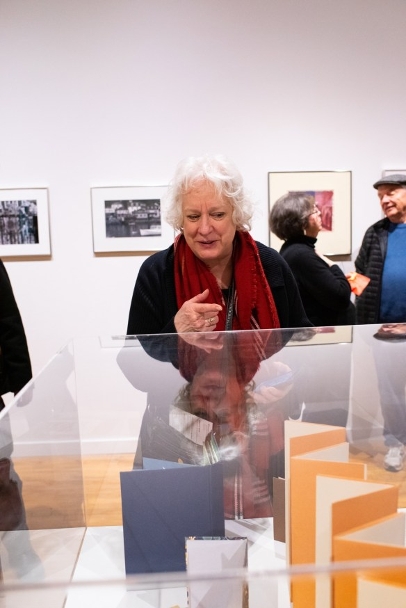 Joanne Kluba looks at artwork by Robert C. Smith at his Retrospective Exhibit Opening, Des Lee Gallery, St. Louis, MO