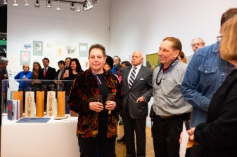 Robert C. Smith's daughter Val Smith (center) and his son Rick Smith (right) at their father's Retrospective Exhibit Opening, Des Lee Gallery, St. Louis, MO