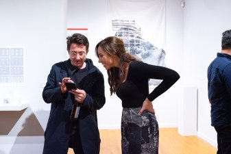 """Assistant Prof. Constance Vale talks with Matthew Au of the Southern California Institute of Architecture at the opening Reception of the exhibit she curated titled """"Decoys and Depictions: Images of the Digital"""" Exhibition at the Des Lee Gallery, Washington University, St. Louis, MO"""