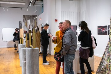 """Associate Professor of Art Arny Nadler and Communications Coordinator Stephanie Schlaifer review work at the Opening Reception of the """"Decoys and Depictions: Images of the Digital"""" Exhibition at the Des Lee Gallery, Washington University, St. Louis, MO"""