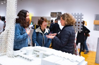 """Suyin Yao (l) and Danning Liang (c) talk withHeather Woofter, Director of the College of Architecture at the Opening reception of the """"Decoys and Depictions: Images of the Digital"""" Exhibition at the Des Lee Gallery, Washington University, St. Louis, MO"""