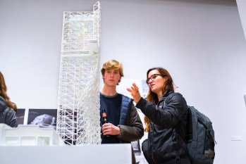 """Patrick Hatheway and Bruna Souza talk about """"Prisim Tower, Winston Salem, NC, 2010 by Sung Ho Kim & Heather Woofter, Axi: Ome LLC"""" at the Opening Reception of the """"Decoys and Depictions: Images of the Digital"""" Exhibition at the Des Lee Gallery, Washington University, St. Louis, MO"""