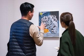 "Takura Suzuki (l) talks about his piece ""Pixelation#1"" with Yeeun Kang at the Parabola: Extraterrestrial Exhibit Opening, Des Lee Gallery, Washington University, St. Louis, MO"