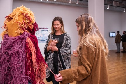"""Liz Moore (r) talks with Ellen Ward about her piece """"Untitled (color and breath/underneath they're living)""""on display at the Parabola: Extraterrestrial Exhibit, Des Lee Gallery, Washington University, St. Louis, MO"""