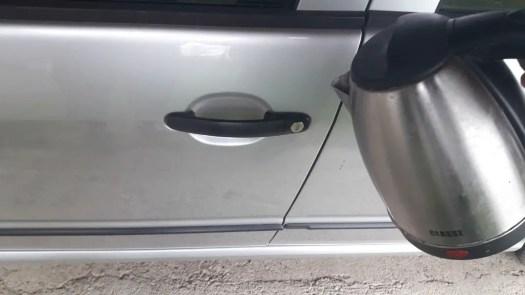 how-to-open-a-frozen-car-door-warm-water
