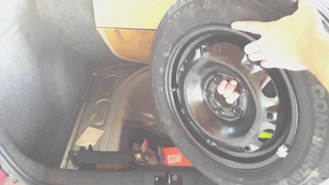 how-to-get-spare-tire-out-of-trunk.