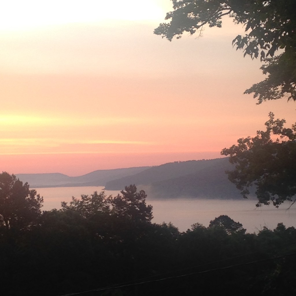 Fog rolls over Greers Ferry Lake at Cove Creek as seen from Cove Cottage.