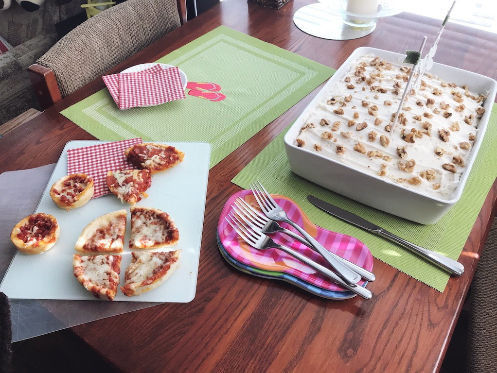 Family birthday traditions made extra special with homemade cake, handmade decorations, and Red Baron Minis and Deep Dish Single pizza. (ad)