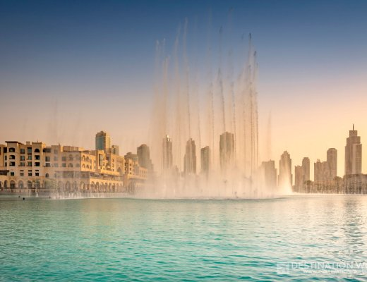 United Arab Emirates, Dubai, Fountain in the Burj Khalifa Lake with Souk Al Bahar during Sunset