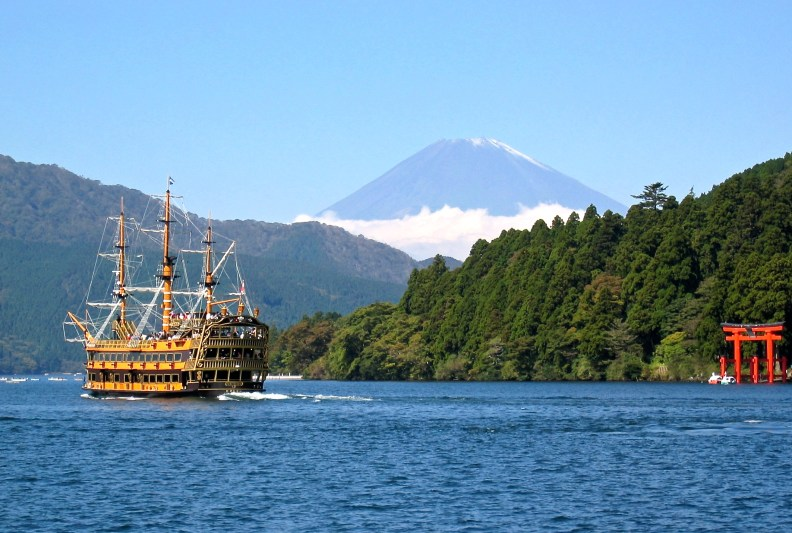 Sightseeing boats cruising Lake Ashi that was formed 3000 years ago in the caldera of  the volcano Mount Hakone.