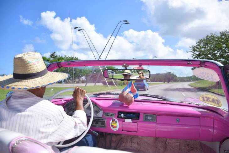 riding in a vintage car Havana